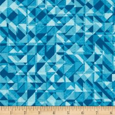 From StudioE Fabrics, this 108'' wide quilt back fabric is perfect for quilt backings, curtains, duvet covers and more. Colors include shades of turquoise.