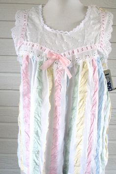 Vintage Pajamas Lorraine NOS NWT. Seersucker shorty pajamas for Spring.  Colors of the pastel rainbow. White eyelet ribbon on the bodice with