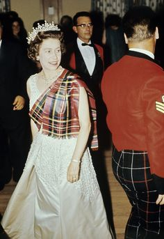 Pin for Later: Inside the Queen's Balmoral Photo Album The queen in diamonds and tartan Her majesty often dances a few Scottish reels with her staff and her neighbors.