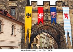 Banners with swallow tails The detail of Old Town bridge tower with medieval flags, Prague