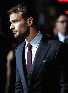 Clean and simple. Maroon tie.