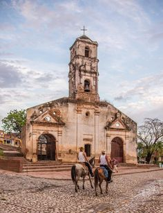 Cuban Cowboys and Crumbling Old Church  // In a section of old Trinidad, a UNESCO World Heritage Site in the center south of Cuba, south Havana // © MARTIN FENSTERSHEIB // #SanctiSpiritus #Caribbean