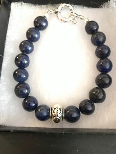 A personal favorite from my Etsy shop https://www.etsy.com/ca/listing/560467641/gemstone-bracelet-lapis-stone-with