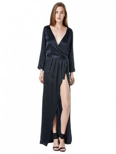 Be sexy in an unexpected way with a daring slit. // Bianca Bell Sleeve Silk Dress by Again Collection