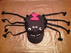 Black Widow kid's hat-made from pom poms, felt, and wiggle eyes.  Made this for my son's Crazy Hat Day at school.