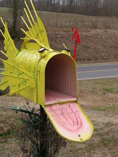 A mailbox made for an avid fisherman. A standard large steel mail box dressed up with fins, auto mirrors and reflectors. The inside is painted pink with. Funny Mailboxes, Home Mailboxes, Unique Mailboxes, Painted Mailboxes, Rustic Mailboxes, Mailbox Makeover, Diy Mailbox, Mailbox Ideas, Mailbox Designs