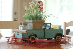 Vintage toy truck as a planter and salt & pepper caddy. Cute for the summer!