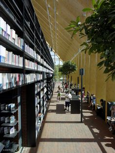 """Nicknamed """"Book Mountain"""" by its designers at Dutch architecture firm MVRDV, the new square foot public library in Spijkenisse, Netherlands is an Modern Library, Library Design, Library Architecture, Interior Architecture, Book Storage, Library Books, Bookshelves, Illustrations, Montana"""