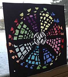 Rose window project. This is for the principle of pattern. Students design their own rose window and create it using construction paper and tissue paper.