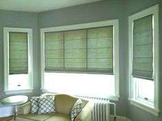 Custom Roman Blinds Note seaming on large blind spaced to match window divisions - a professional touch