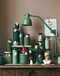 DIY Advent Calendars - Save glass jars, dip in paint, add number and gift.