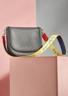 Grey saddle bag with brighten up your day yellow stripe strap from our 'Love Your Handles' collection of bags and straps #Loveyourhandles