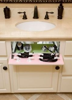 A flip drawer reveals hidden storage for electrical hair appliances.