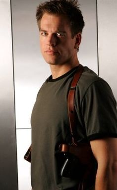 DiNozzo showing off a little shoulder holster.