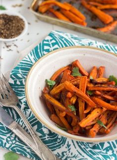 Coconut Cumin Roasted Carrots - A SUPER easy side dish that is healthy, gluten and PACKED with flavor! | Foodfaithfitness.com | #recipe