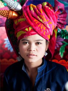 Pa O wedding ceremony, Myanmar / Burma.  Pic by Corrie Wingate  Bride wearing colourful headdress at a Pa O wedding ceremony in Shan State, Myanmar. The Pa O people are also known as the Kayin, a fiercely independent minority who make up about seven percent of Myanmar's population.  The Burmese are not a homogeneous people. Within its population of about 60 million, the Burmese government recognises 135 separate nationalities, and over 240 languages and dialects are spoken throughout the…