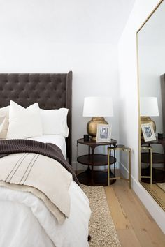 """On the guest bedroom: """"We wanted the guest bedroom in the main house to feel like its own small suite. Guest chairs were added to create an intimate conversation nook. A taupe velvet tufted bed,..."""