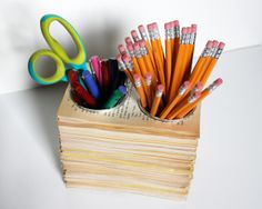 Use old book pages to make this pencil, pen and other supplies holder from http://the3rsblog.wordpress.com/2011/11/08/book-pages-pencil-cups/