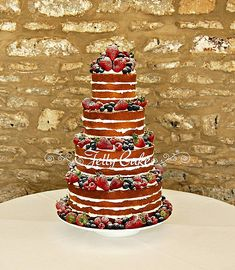 Natural naked Wedding Cake I wAnt this 3 tier with strawberries and blackberries. Red velvet.