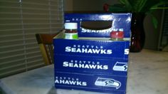 Tailgating. Football. Seattle Seahawks. Condiment Holder.  6 Pack Cardboard Box and Seahawks branded Duct Tape.  Makes it waterproof and themed for the game.  Took about an hour.