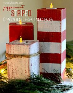 peppermint striped candlesticks made from wooden posts. #candycane #candles #christmasdecorations