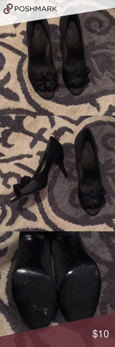 black satin ruffle pumps Black ruffle satin peep toe pumps. These have been gently worn and I have done my best to show the wear on the sole. no scuffs on the satin.  This is also reflected in the price. Despite their wear they have been well cared for. I am open to offers! i've found these shoes elsewhere also pre-loved at higher prices- this price is the best i've found, they are in good condition and i am still open to offers :) Touch of Nina Shoes Heels