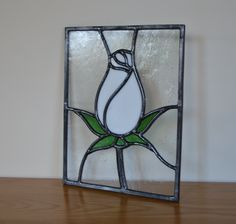 A stained glass rosebud - the perfect wedding gift and it'll never fade! Designed and made by Radiance Stained Glass.