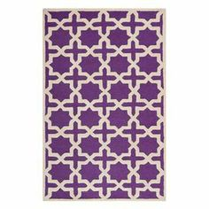"""Bring textured appeal to your living room or den with this hand-tufted wool rug, showcasing an eye-catching trellis motif in purple and ivory.  Product: RugConstruction Material: WoolColor: Purple and ivoryFeatures:  Hand-tuftedTrellis motifPile Height:0.63""""Note: Please be aware that actual colors may vary from those shown on your screen. Accent rugs may also not show the entire pattern that the corresponding area rugs have."""