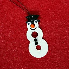 Snowman Washer Necklace - Kids can make this fun necklace using washers from the hardware store.