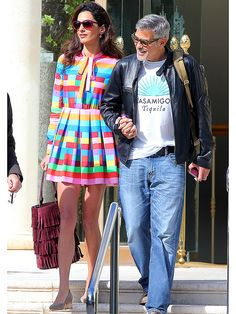 Amal Clooney in a rainbow RED Valentino mini dress and fringe bucket bag