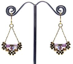 Beaded Earbobs pattern  http://www.aroundthebeadingtable.com/Patterns/BeadedEar.html