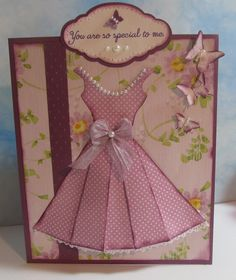 Pleated paper dress card.