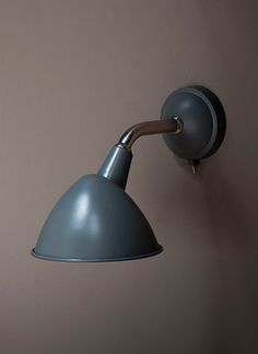 A stylish indoor wall light in charcoal colour