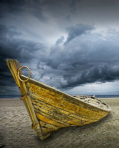 Boat on Beach with Storm Brewing A Fine Art by RandyNyhofPhotos, $12.00