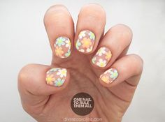 Put a twist on your typical flower nail art with a design built on a blank background for an airy appearance. If you can make dots, you can pull off these flower nails!
