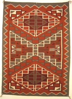 789. Description: Native American, Burnt water Navajo rug / weaving, eastern reservation. Bold pattern not unlike Ganado and Two Grey Hills rugs, but in earth tones. Prior to the Burnt water style, mo