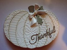 """handmade Thanksgiving card from Card Corner by Candee ... white pumpkin shaped card ... ovals cut out and embossed with different embossing folder textures ... sponged edges ... die cut """"Thankful"""" in script .... great card ...:"""