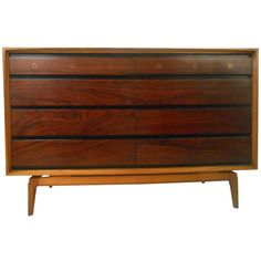 Unique Mid-Century Modern Rosewood Dresser | From a unique collection of antique and modern dressers at https://www.1stdibs.com/furniture/storage-case-pieces/dressers/