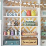Herringbone Bookcase |Craft Room Makeover Paint the back of a bookcase in a fun stencil pattern, organize with mason jars, crates and suitcases!