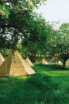 tee-pee wedding- if we go for this one, i like the idea of it feeling a bit like a festival, with tepees through the trees, swings, campfire, hammocks, bunting and a pingpong table