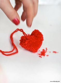 """Love is in the air. Do you feel it, too? I can think of no sweeter way to get started with Valentine's Day preparations than by making these Heart-Shaped Pom-poms! These are a great first """" specialty pom-pom"""" if you've never made one other than the classics before. I can think of 1 million ways"""