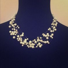 Dainty Floating Pearl Necklace NWOT. This necklace is  stunning. Dainty pearls seamlessly floating on invisible lines, make this necklace a beautiful addition to any wardrobe. Perfect for any special occasion! Jewelry Necklaces
