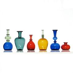 Miniature vases and bottles by Kivaford. Hand blown glass miniatures. Really love his work