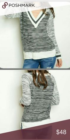 Coming Soon! Cozy V-Neck Varsity Sweater Marbled v-neck varsity sweater in black, gray, and white. Classic look in multiple sizes. 100 % acrylic. Cozy and stylish. I love this one! Boutique Sweaters V-Necks