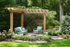 Stone pie shaped wood-burning fire pit in the corner of a small garden patio