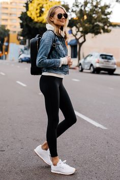Blonde Woman Wearing Athleisure Outfit Denim Jacket Grey Sweatshirt Black Leggings Reebok Classic White Sneakers Black Calpack Backpack Fashion Jackson San Diego Fashion Blogger Street Style