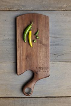 Handcrafted Walnut Wood Cutting Board With Handle For the Kitchen