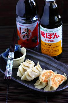 Gyoza- tiny parcel of juicy filling encased in a dumpling wrapper, pan-fried to crispy golden brown at the bottom, and then lightly steamed to create the nice contrast in mouth feel and texture. #japanese #appetizer #pork #mizkan