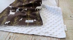 Baby boy is sure to snuggle with this minky baby blanket for years to come. Super stylish and modern woodland baby blanket will match many nurseries. This white minky blanket is super soft and warm an