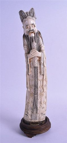 A LARGE EARLY 20TH CENTURY CHINESE CARVED IVORY FIGURE OF AN IMMORTAL modelled in foliate embellished robes. 35.5 cm high.